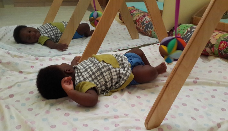 Taking a break to smile at himself. Apart from helping with the development of coordinated movement, the mirror helps the child in the development of his body schema