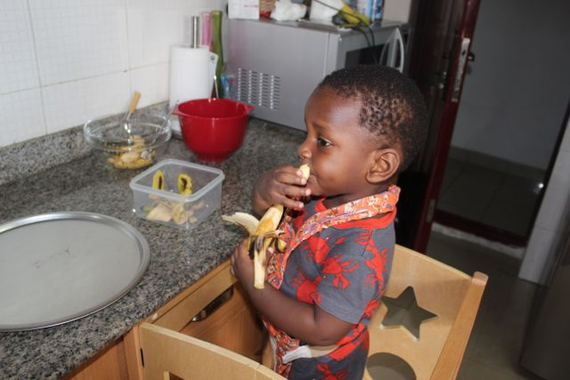 After mashing each banana, I would move the bowl away, bring a new banana and the bowl for the peels.  You knew he was eventually going to taste it right?