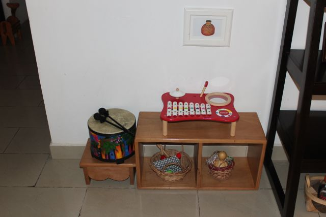 In the place where his shelf was formerly located, we put a music shelf. You might remember this was his first living room shelf from when he was about 6 months old. The drum and xylophone are always there but the baskets and picture are rotated.