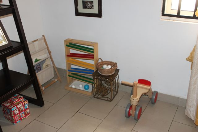 This area has his ball tracker. This is  favorite so we have not moved it since we got it. He uses it several times daily. We swapped his walker wagon for a tricycle. His wagon in available in another part of the house and he can go get it and use it when he wants but the tricycle is what is currently within view when he is in the living room.