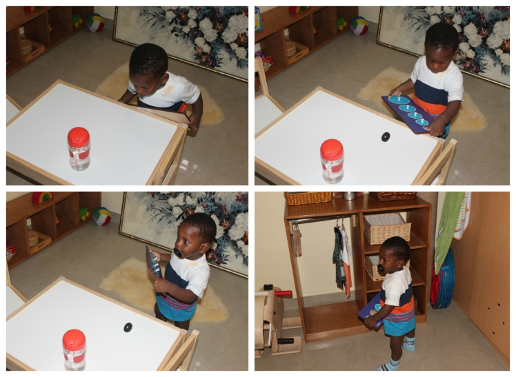 He put the piece on the table from him mouth and picked another piece with his mouth.  Ok? Maybe he is inventing a new mouth transfer game? But no, he did not drop the second piece... He decided to walk to his closet area... I'm still watching.