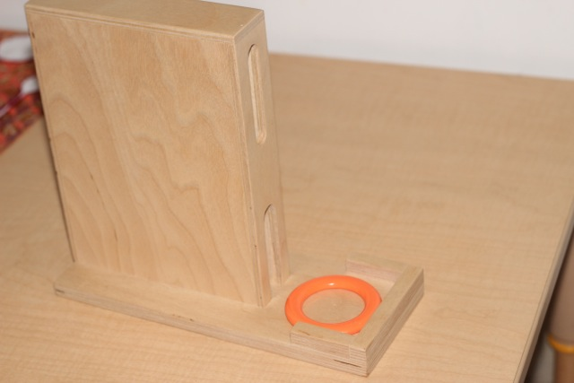 This is a fun material which provides just the right level of challenge. He has to hold the ring a certain way and and position it correctly to feed it in. It also has to go into the top hole to come down the ramp. He enjoys it and it holds his attention for a few minutes.