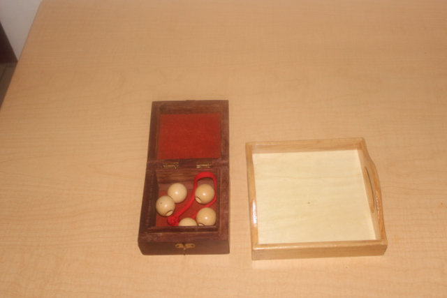 Beads and lace in an interesting box with another opportunity to open and close