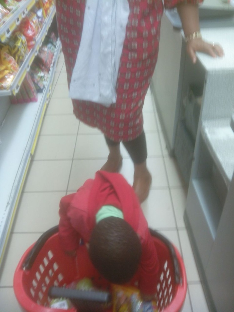 I love how my mum is just standing in the background and letting him unload the cart. This is such fun for a toddler and going to the store became one of Solu's highlights of the week. Why is this an activity? Think about it. Standing, bending, lifting - gross motor, repetition, language, grace and courtesy...