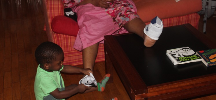 He had mastered putting on socks on his feet and now enjoyed putting them on Metu or any other willing adults.